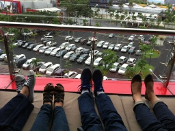 Relaxing with our friends after good food in Surabaya. Guess which feet are ours!