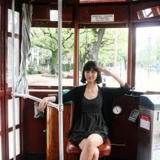 Alysta in a streetcar